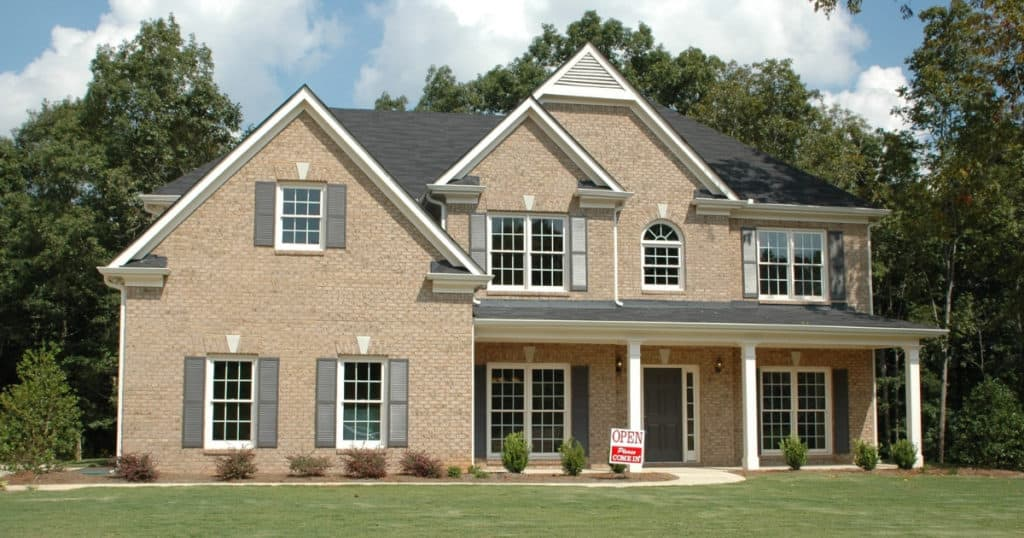 a large house sitting on land shows the trust cost of home ownership