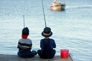 Boys fishing on a dock
