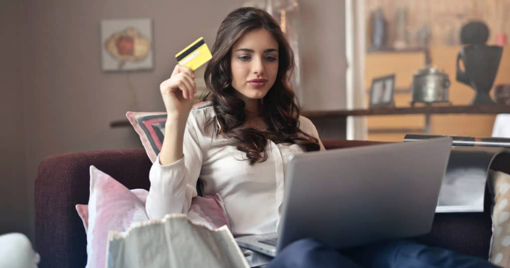 girl shopping online with credit card