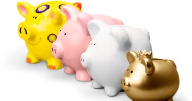 four different piggy banks lined up for family budget meeting