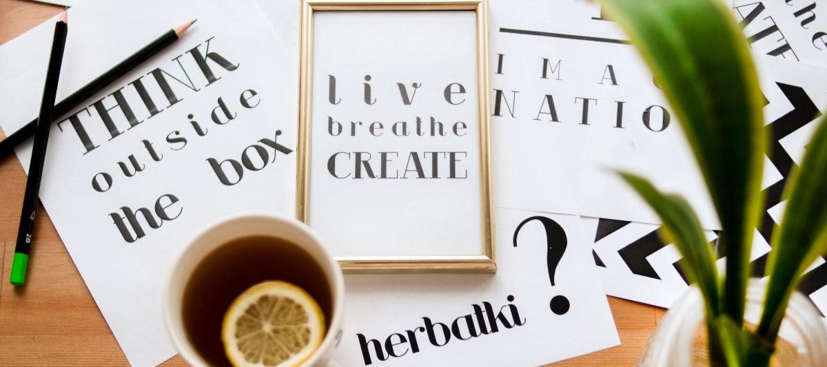 motivational quote prints on desk