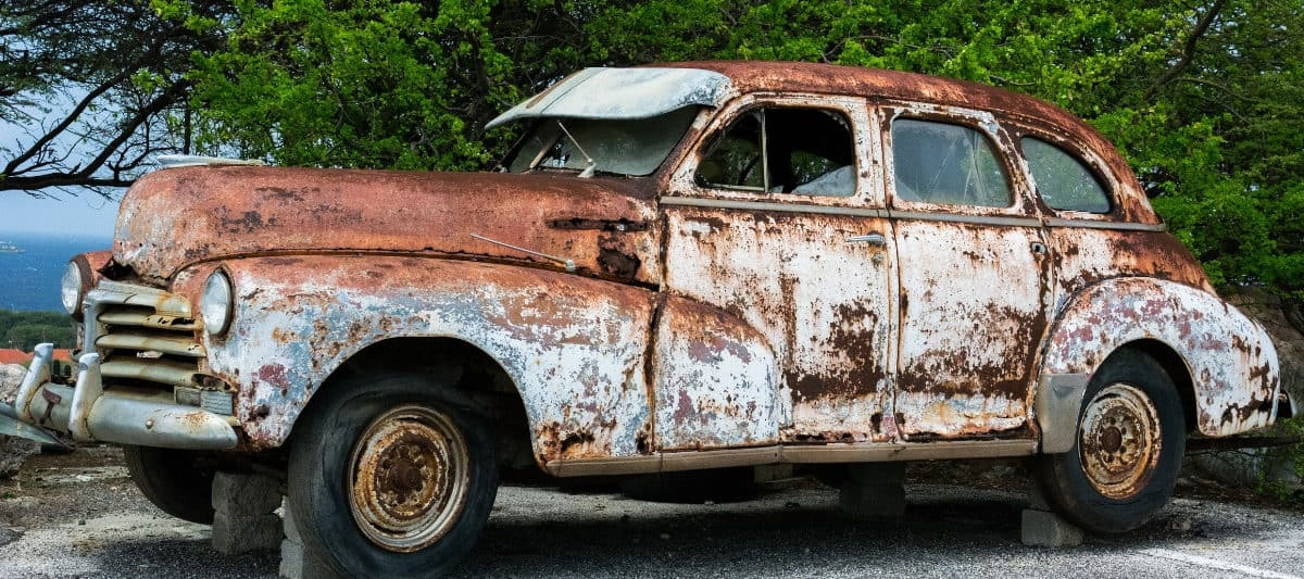 old rusty car as a symbol of the worst finance advice we have heard