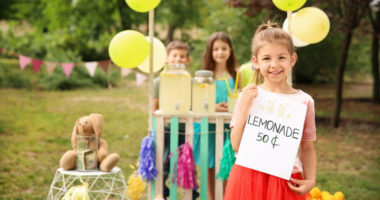 group of Young Entrepreneurs with a lemonade stand as a small business idea
