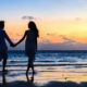 couple walking on beach holding hands trying to understand social security payments