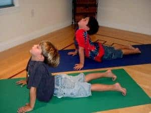 young boys doing yoga