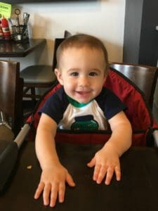 Baby in high chair at cafe