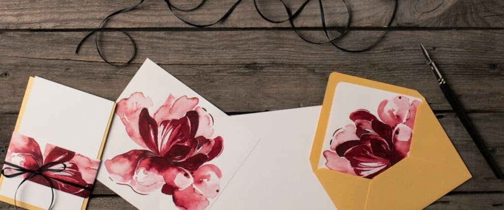 Sample invitations designed with flowers by a graphic designer
