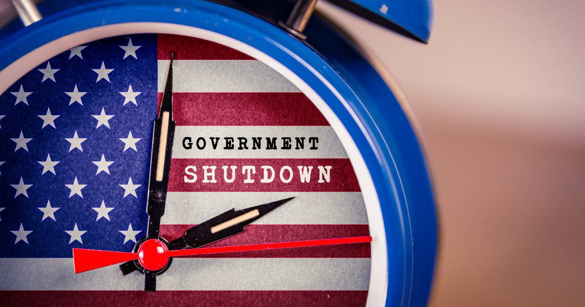 Clock counting time of government shutdown and how it impacted one family's budget