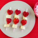 Heart shaped strawberries and bananas on skewer for Valentine's Day with kids