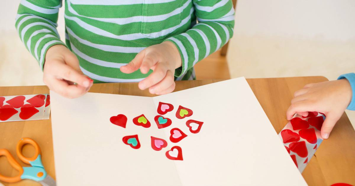 Awesome Valentine's activities for kids - Child making Valentine's cards