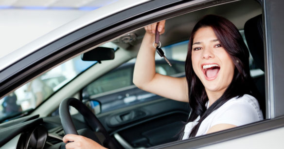 woman excited after buying a car