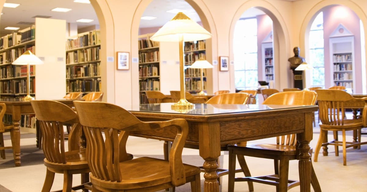Desks in a library where you can learn more about what libraries offer