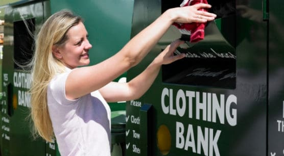 woman donating clothing to a drop off location as part of strategy to prepare to file taxes