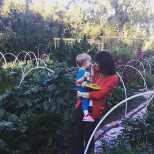 Mom and child in large vegetable garden