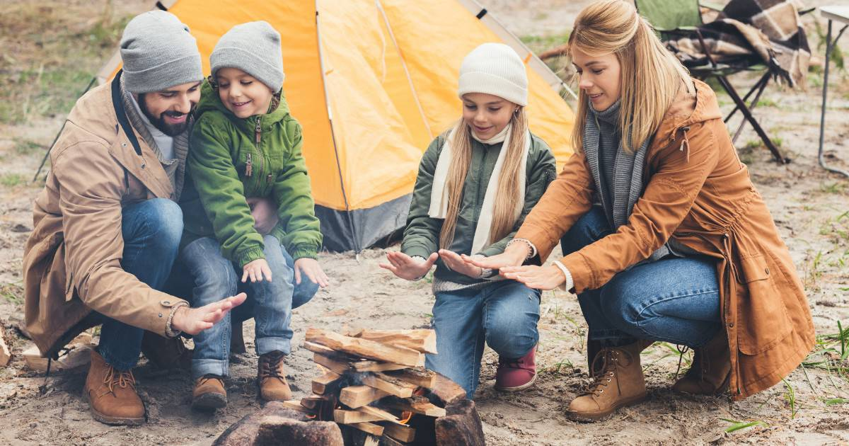 camping with young children around campfire