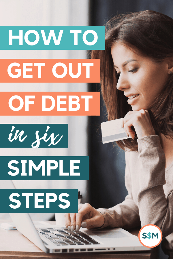 How to Get Out of Debt in Six Simple Steps - woman holding credit card