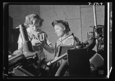 Women in industry. Tool production. Pioneers of the production line, these two young workers are among the first women ever to operate a centerless grinder, a machine requiring both the knowledge of precision measuring instruments, and considerable experience and skill in setting up.